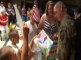 Soldier Reunites With Family After Tour In Afghanistan