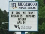 Students Stand Up For 'In God We Trust' On School Marquee