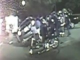 Strangers Band Together To Lift Car Off Trapped Motorcyclist