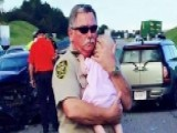 Sherriff's Deputy Comforts Baby After Car Crash
