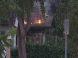 Suspected Gunman Barricaded Inside Burning Building