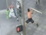 Shirtless Man Attacks Bystanders With Pole