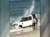 SUV Sinks Into Beach In Photoshoot Gone Wrong