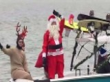 Santa And The Grinch Waterski Down The Potomac River