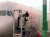 Shocking Video: Man Tries To Pry Open Airplane Door