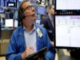Stocks Record Modest Losses Amid US-China Trade Dispute