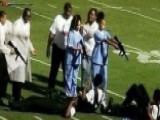 School Marching Band Depicts Kids Pointing Guns At Cops