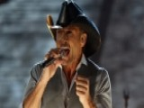 Tim McGraw 'swatted' Fan