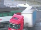 Train Plows Into Semi-truck's Trailer