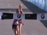 Teen Helps Collapsing Marathon Winner Across Finish Line