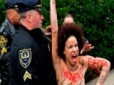 Topless Protester Charges Bill Cosby As He Arrives For Trial
