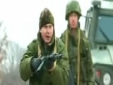 Ukrainian Soldiers Confront Russian Forces At Airbase