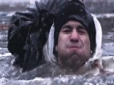 US Soldiers Endure Ice Jump Training In Freezing River