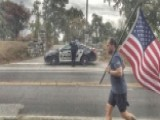 Viral Photo Captures Police Paying Respects To Old Glory