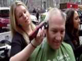 Volunteers Shave Their Heads To Help Cure Childhood Cancer