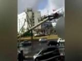 Watch Massive Billboard Flatten Cars Driving Down Busy Road