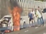 Woman Pulled From Burning Car By Total Strangers