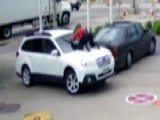 Woman Jumps On SUV, Hangs On For Dear Life To Stop Car Thief