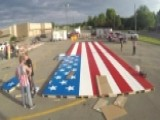 Watch Volunteers Assemble The World's Largest Lego Flag