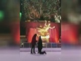 Woman Wipes Out On Ice Rink As Boyfriend Proposes