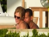 Alex Rodriguez And Torrie Wilson Cuddle Up Poolside