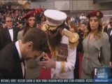Sacha Baron Cohen Pours Ashes On Ryan Seacrest
