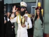 Sacha Baron Cohen's Dictator Spills Ashes On Ryan Seacrest At Oscars