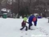 Father Of The Year Plays With Son In Snow