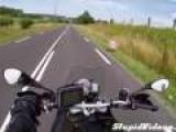 Biker Almost Hit By Open Truck Gate