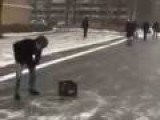 Curling With Beer Crates On Iced Over Street
