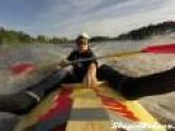 In A Kayak Being Towed By A Motorboat