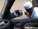Man Shaves In Car's Side Mirror