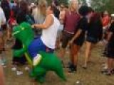 Man At Concert Dances In Dinosaur Costume