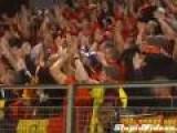 Soccer Fans Exchange Scarves