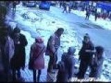Snow Falls Off Roof Burying Pedestrians