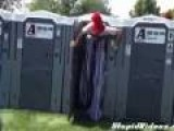 Tall Man Uses Port-O-Potty