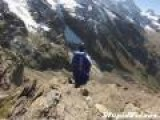 Wingsuit Flight Through Gap In Rocks