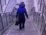 Woman Takes Tumble Down Staircase