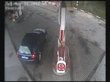 Woman Takes Gas Pump As She Leaves Gas Station